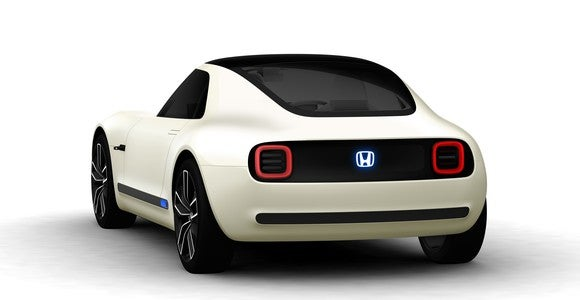 Honda's Sports EV Concept, a futuristic white coupe, shown from behind.