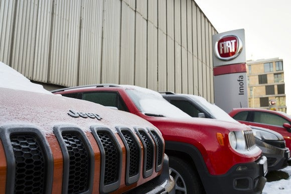 Jeeps lined up outside a Fiat Chrysler building.