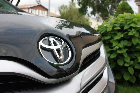 Front grill of a Toyota with logo.