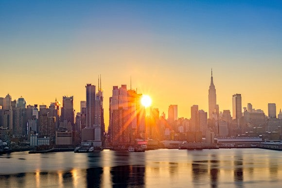 Sunrise over New York City skyline.