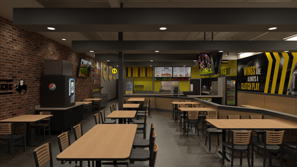 Dining area with tables and chairs at a B-Dubs Express restaurant location.
