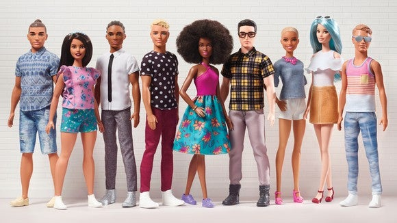 A diverse lineup of Barbie and Ken dolls from the new Fashionistas collection.