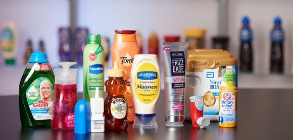 Various products that use AptarGroup's dispensing solutions, including dis soap, mayonnaise,, honey, and baby formula