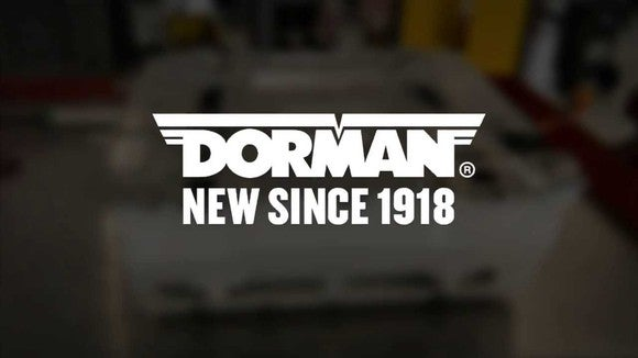 Dorman logo in front of a hazy image of an engine block.