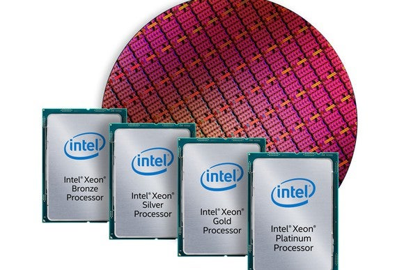 A wafer of Intel chips with finished chips in front of it.