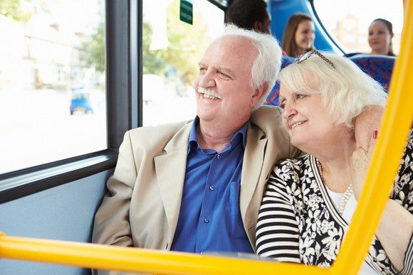 Senior couple looking out a bus window