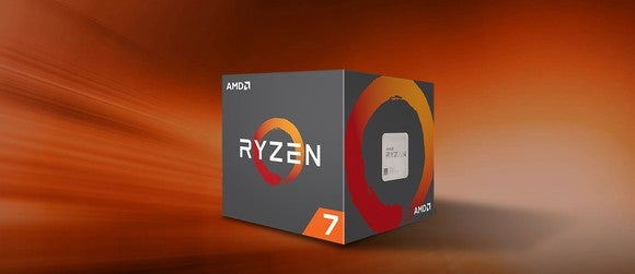 Box containing AMD Ryzen 7 chip, against an orange background that matches the color scheme of the box.
