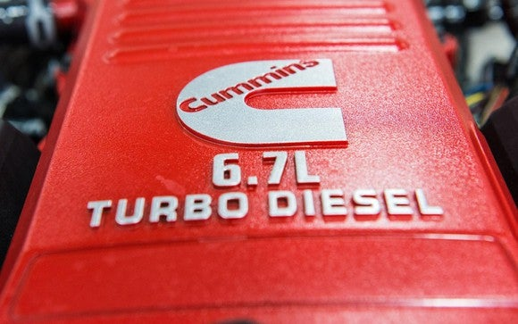 Cummins turbo-diesel engine in red with the Cummins logo on it.