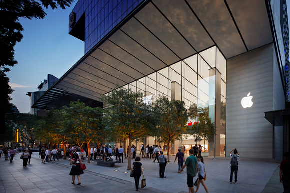 Customers seen walking into Apple's sleek store in Singapore.