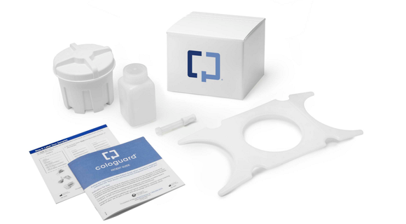 The contents of a Cologuard kit on display.