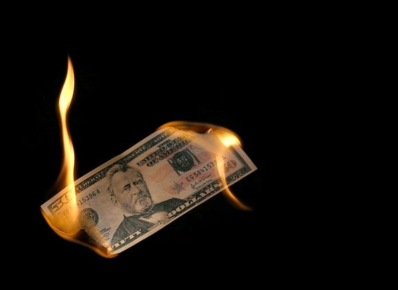 A $50 bill on fire.