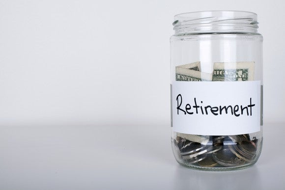 Jar labeled retirement filled with money.