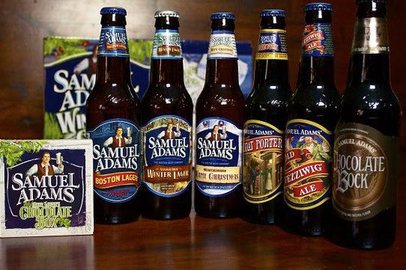 Six bottles lined up in a row from Boston Beer's Sam Adams lineup.