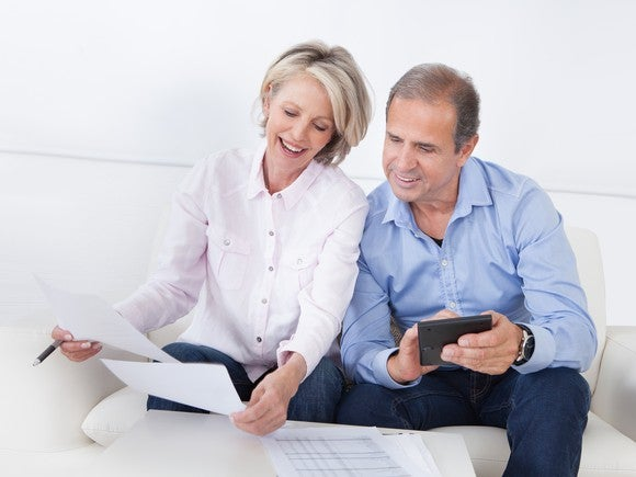 50-something couple looking at paperwork.