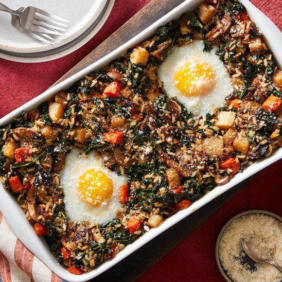 A dish with kale and fried eggs