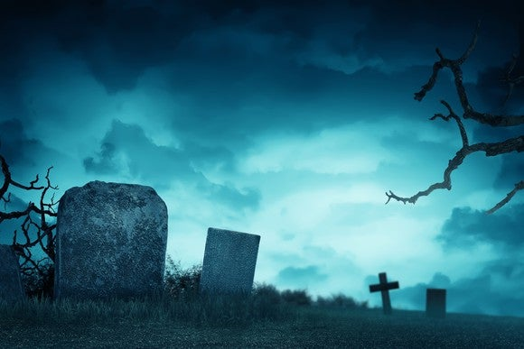 Gravestones in front of a stormy sky