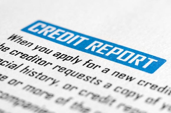 A closeup of a piece of paper titled Credit Report