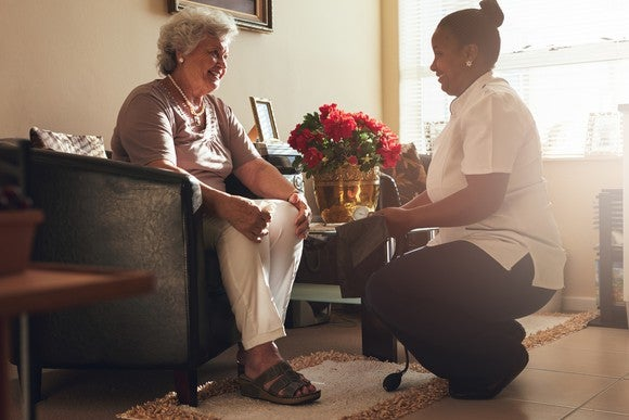 A nurse and her elderly patient in a senior housing facility