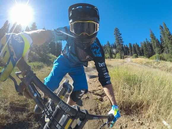 A person using a GoPro mounted camera on their mountain bike.