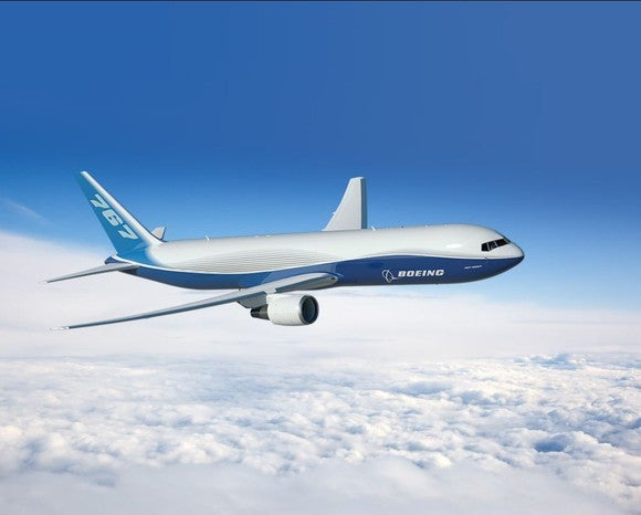 A rendering of a Boeing 767 flying over clouds