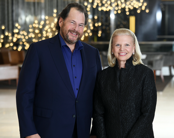 Salesforce CEO Marc Benioff and IBM CEO Ginni Rometty stand side by side