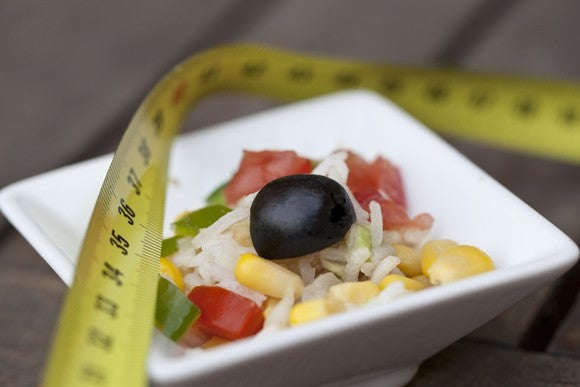 Bowl of food with a tape measure on top