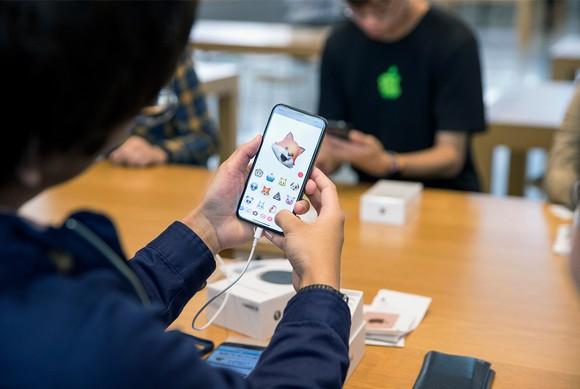 Woman using Animoji on iPhone X
