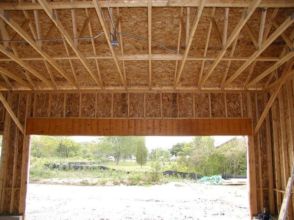 Garage frame showing wood beams and plywood used in construction.