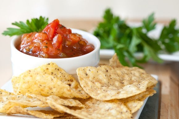 Chips next to a bowl of salsa