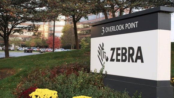 Zebra Technology's logo on a sign outside the company HQ campus in Lincolnshire, Illinois.