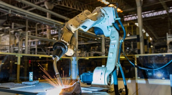 A robotic welding arm in a factory.