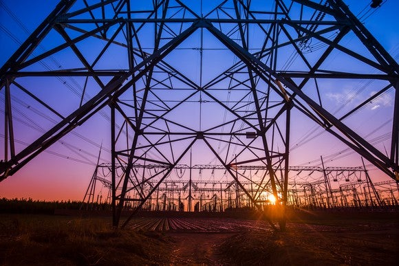 Electric transmission lines at sunset.