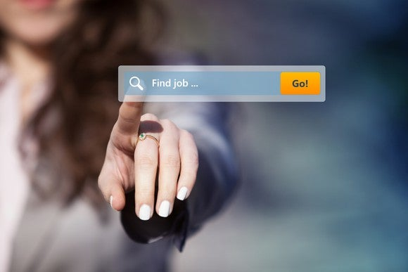 A woman touches a search icon on a transparent screen that reads find job.