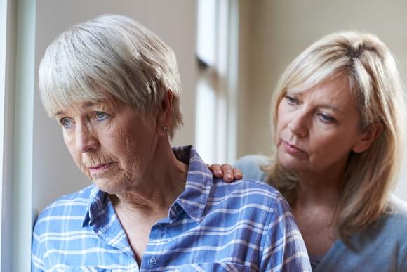 Woman comforting an older woman
