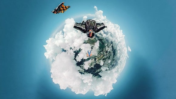 Tiny world photo of people skydiving.