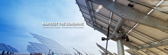 Several freestanding solar module units, with text reading Harvest the Sunshine.