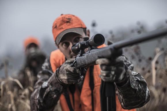 Hunter with scoped Remington rifle