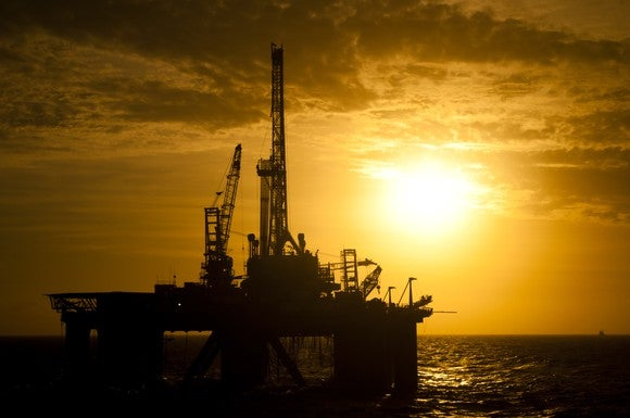 offshore oil rig at sunset.