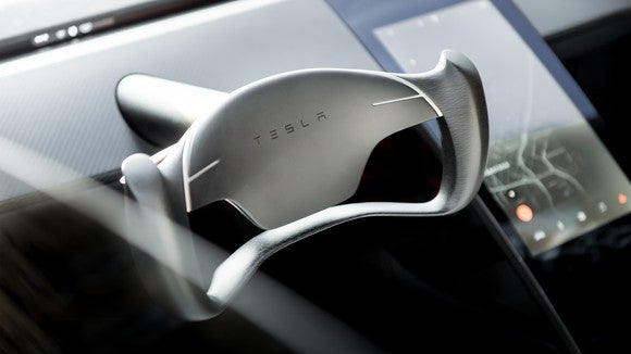 The steering wheel and center touchscreen console on Tesla's new Roadster.