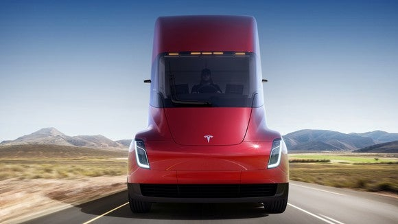 The front of a red Tesla Semi.