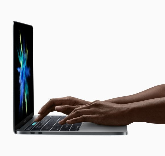A person using Apple's redesigned MacBook Pro