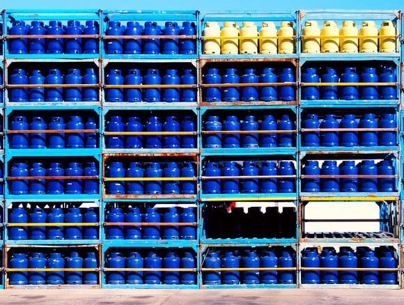 Propane tanks stacked on shelves