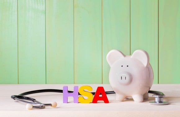 The letters HSA, a stethoscope, and a piggy bank