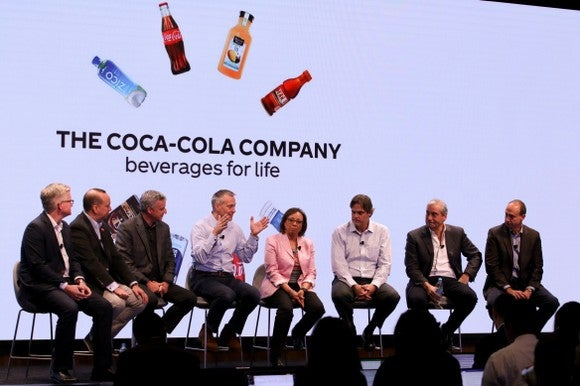 Senior leadership of Coca-Cola on stage, answering questions at the company's 2017 investor day conference.