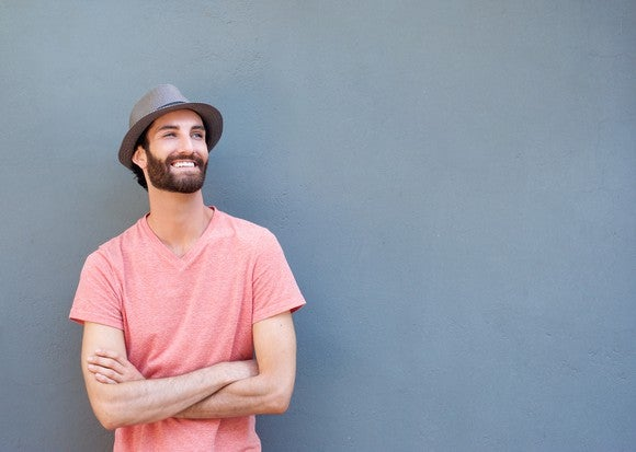 Smiling younger male in t-shirt and hat