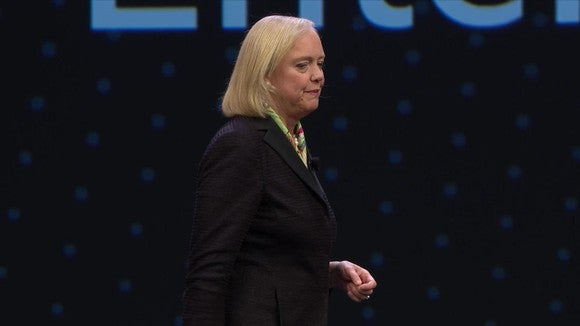 Meg Whitman on a stage under an Hewlett Packard Enterprise banner.