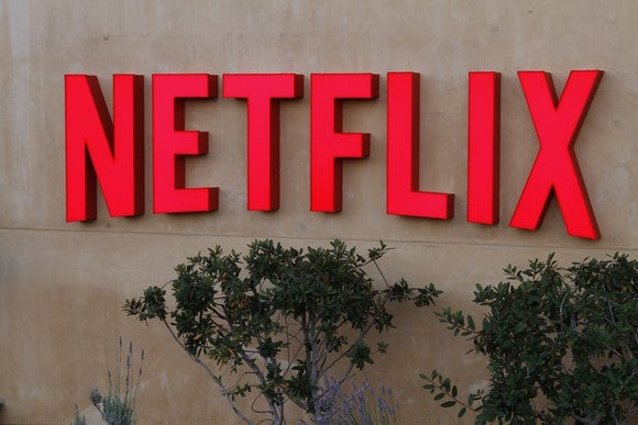 Red Netflix logo on a stucco wall