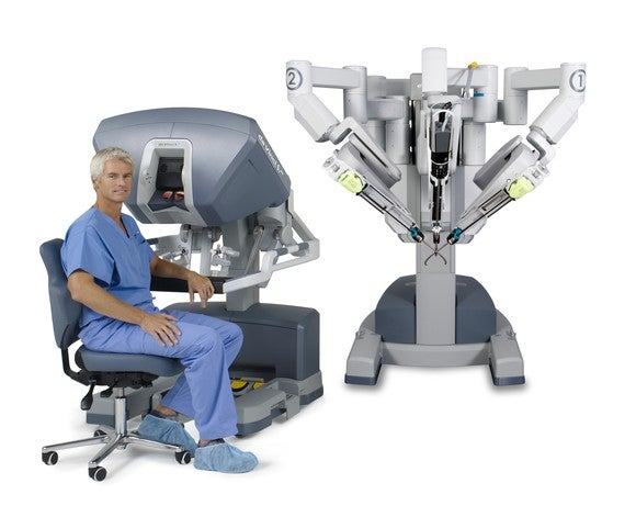 Surgeon seated at a da Vinci surgical system from Intuitive Surgical