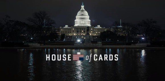 The House of Cards logo in front of the U.S. Capitol building at night