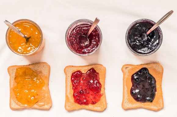 Three sandwiches with peanut butter and jelly.
